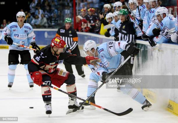 Vitalij Aab of Hamburg and Nikolai Goc of Hannover fight for the puck during the DEL match between Hamburg Freezers and Hannover Scorpions at the...