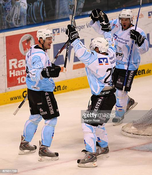 Vitalij Aab Paul Manning and Francois Fortier of Hamburg celebrate the 1st gooal during the DEL match between Hamburg Freezers and Frankfurt Lions at...