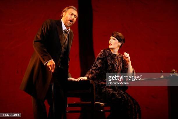 "Vitaliy Bilyy, left, and Adela Zaharia perform as in Los Angeles Opera's production of Verdi's ""La Traviata,"" at the Dorothy Chandler Pavilion in Los..."