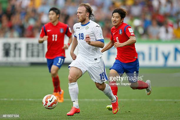 Vitaliy Denisov of Uzbekistan runs with the ball during the 2015 Asian Cup match between Korea Republic and Uzbekistan at AAMI Park on January 22...