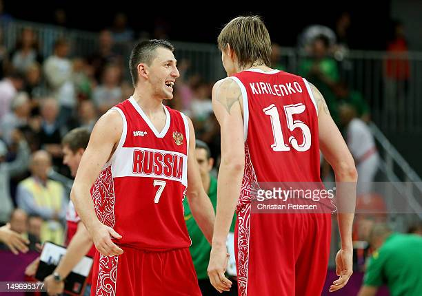 Vitaliy Fridzon of Russia celebrates with teammate Andrey Kirilenko after hitting a threepoint shot to win the game 7574 over Brazil during the Men's...