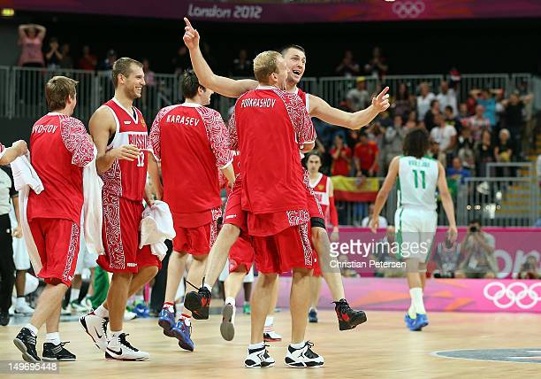 Vitaliy Fridzon of Russia celebrates with teammate Anton Ponkrashov after hitting a threepoint shot to win the game 7574 over Brazil during the Men's...