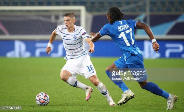 Vitaliy Mykolenko of Kyiv battles for the ball with Jordan Botaka of KAA Gent during the UEFA Champions League PlayOff first leg match between KAA...