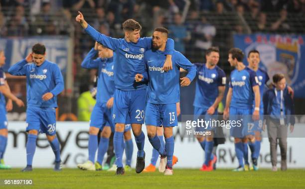 Vitaly Janelt of Bochum and Sidney Sam celebrate after winning the Second Bundesliga match between VfL Bochum 1848 and 1 FC Kaiserslautern at Vonovia...
