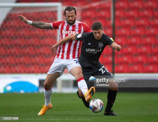 Vitaly Janelt of Brentford and Steven Fletcher of Stoke City in action during the Sky Bet Championship match between Stoke City and Brentford at...