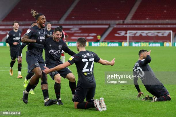Vitaly Janelt of Brentford celebrates with teammates Ivan Toney and Sergi Canos after scoring his team's second goal during the Sky Bet Championship...