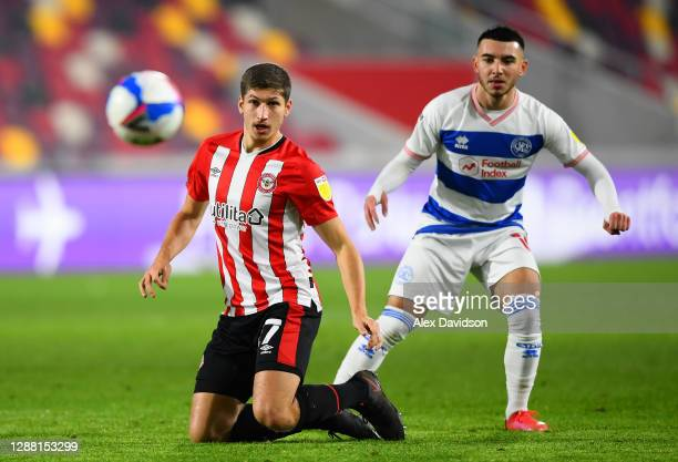 Vitaly Janelt of Brentford is challenged by Ilias Chair of Queens Park Rangers during the Sky Bet Championship match between Brentford and Queens...