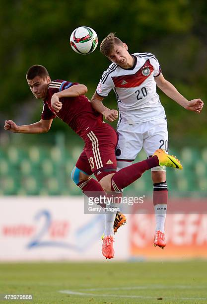Vitaly Janelt of Germany U17 challenges Daniel Nesseler of Russia U17 during the UEFA European Under17 Championship Semi Final match between Germany...