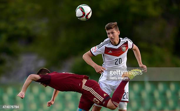 Vitaly Janelt of Germany U17 challenges Daniel Nesseler of Russia U17 during the UEFA European Under17 Championship Semi Final match between Germany...