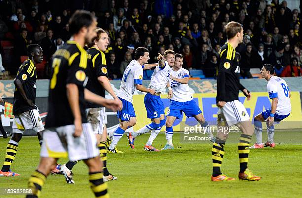 Vitaly Mandziuk of FC Dnipro Dnipropetrovsk celebrates scoring his teams second goal during the UEFA Europa League group stage match between AIK...