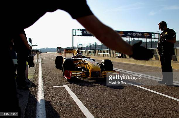 Vitaly Petrov of Russia and Renault drives in for a pit stop during winter testing at the Ricardo Tormo Circuit on February 3, 2010 in Valencia,...