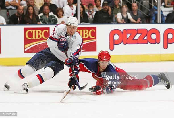 Vitaly Vishnevski of Team Russia checks Marian Gaborik of Team Slovakia off the puck during the second period of their game in the World Cup of...