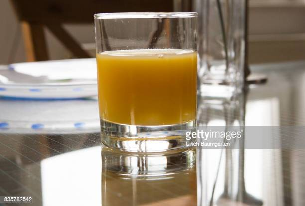 Vitamin C Allroundgenie in terms of human health The photo shows a glass filled with orange juice