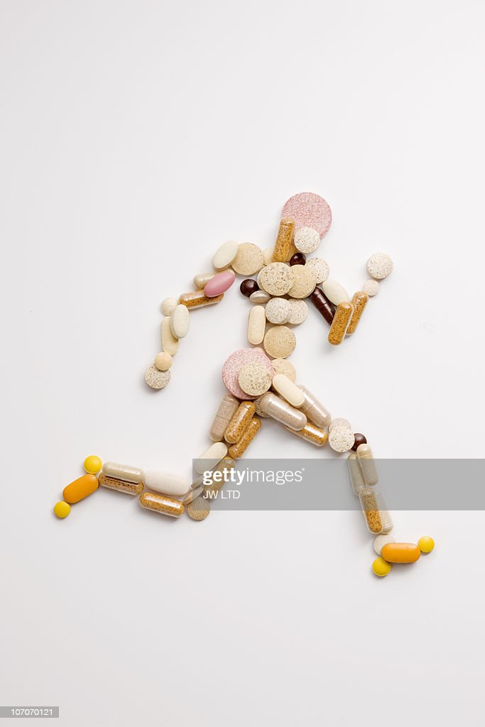 Vitamin pills in shape of man running : Photo