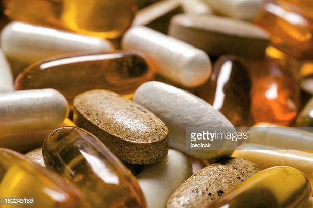 vitamin pills - nutritional supplement stock pictures, royalty-free photos & images