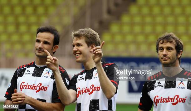 Vitantonio Liuzzi of Italy and Force India Sebastian Vettel of Germany and Red Bull Racing and Jarno Trulli of Italy and Lotus are pictured ahead the...