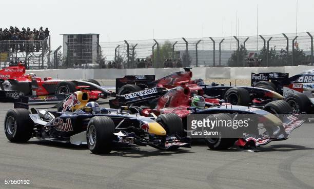 Vitantonio Liuzzi of Italy and Scuderia Toro Rosso crashes into David Coulthard of Great Britain and Red Bull Racing during the F1 Grand prix of...