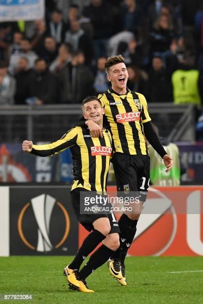 Vitesse Arnhem's forward from Netherlands Brian Linssen celebrates with teammate Vitesse Arnhem's midfielder from England Mason Mount after scoring...