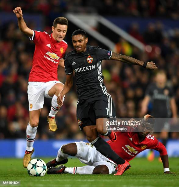 Vitinho of CSKA Moscow escapes the challenge of Paul Pogba of Manchester United and Ander Herrera of Manchester United during the UEFA Champions...