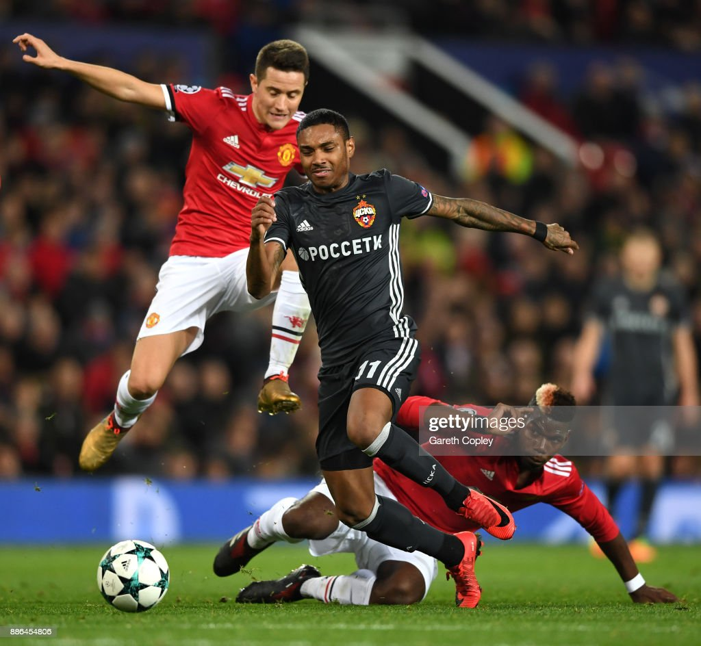 Vitinho of CSKA Moscow escapes the challenge of Paul Pogba of Manchester United and Ander Herrera of Manchester United during the UEFA Champions League group A match between Manchester United and CSKA Moskva at Old Trafford on December 5, 2017 in Manchester, United Kingdom.