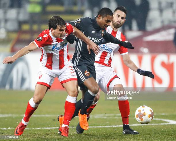 Vitinho of CSKA Moscow is challenged by Filip Stojkovic and Damien Le Tallec of Crvena Zvezda during UEFA Europa League Round of 32 match between...