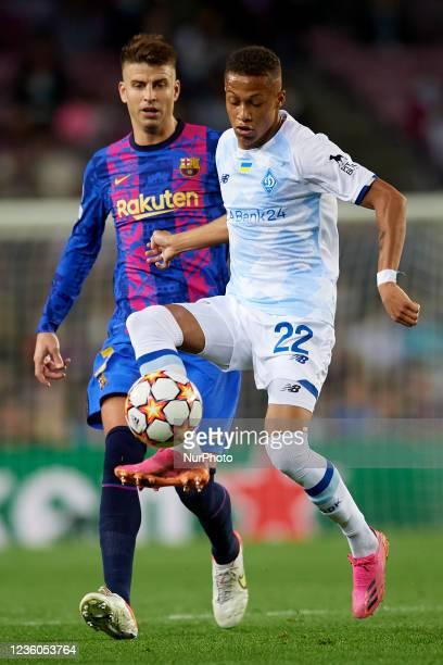 Vitinho of Dinamo Kiev and Gerard Pique of Barcelona during the UEFA Champions League group E match between FC Barcelona and Dinamo Kiev at Camp Nou...