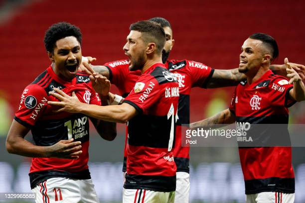 Vitinho of Flamengo celebrates with teammates after scoring the third goal of his team during a round of sixteen second leg match between Flamengo...