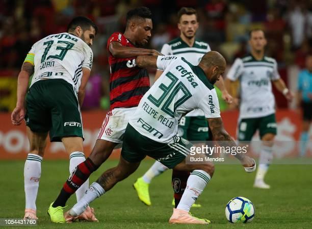 Vitinho of Flamengo struggles for the ball with Felipe Melo of Palmeiras during a match between Flamengo and Palmeiras as part of Brasileirao Series...