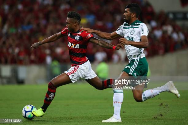 Vitinho of Flamengo struggles for the ball with Thiago Santos of Palmeiras during a match between Flamengo and Palmeiras as part of Brasileirao...