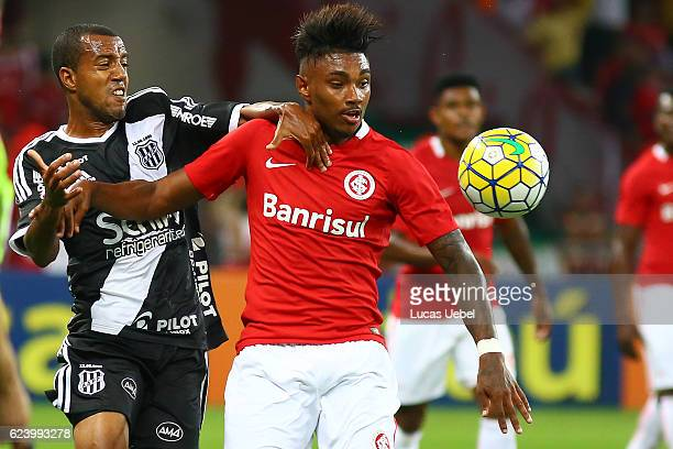 Vitinho of Internacional battles for the ball against Breno Lopes of Ponte Preta during the match between Internacional and Ponte Preta as part of...