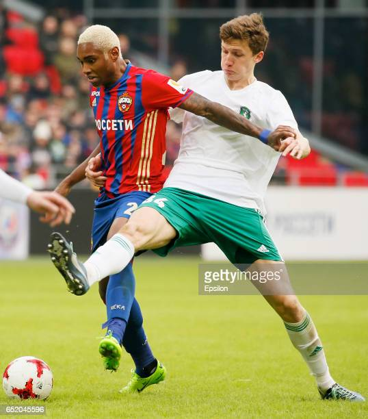 Vitinho of PFC CSKA Moscow challenged by Anton Miterev of FC Tom Tomsk during the Russian Premier League match between PFC CSKA Moscow and FC Tom...