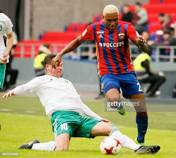 Vitinho of PFC CSKA Moscow challenged by Sergey Kuznetsov of FC Tom Tomsk during the Russian Premier League match between PFC CSKA Moscow and FC Tom...