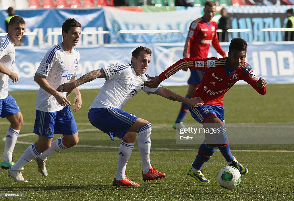 Vitinho of PFC CSKA Moscow is challenged by Luke Wilkshire of FC Dinamo Moscow during the Russian Premier League match between PFC CSKA Moscow and FC Dinamo Moscow on October 6, 2013 in Moscow, Russia. (Photo b /Epsilon/Getty Images)Luke Wilkshire;Vitinho