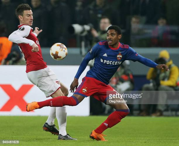 Vitinho of PFC CSKA Moskva vies for the ball with Laurent Koscielny of Arsenal FC during the UEFA Europa League quarter final leg two match between...
