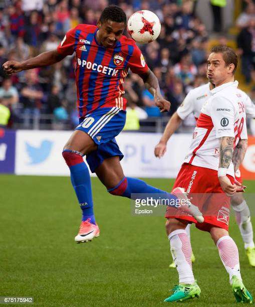 Vitinho PFC CSKA Moscow vies for the ball with Andrey Yeshchenko of FC Spartak Moscow during the Russian Premier League match between PFC CSKA Moscow...