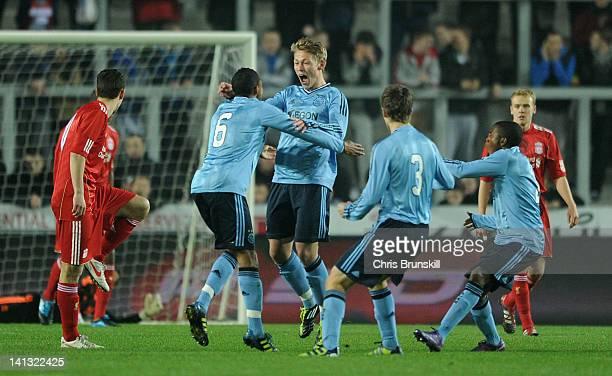 Vitkor Fischer of Ajax celebrates scoring the opening goal with teammates during the NextGen Series Semi-Final match between Liverpool U19 and Ajax...