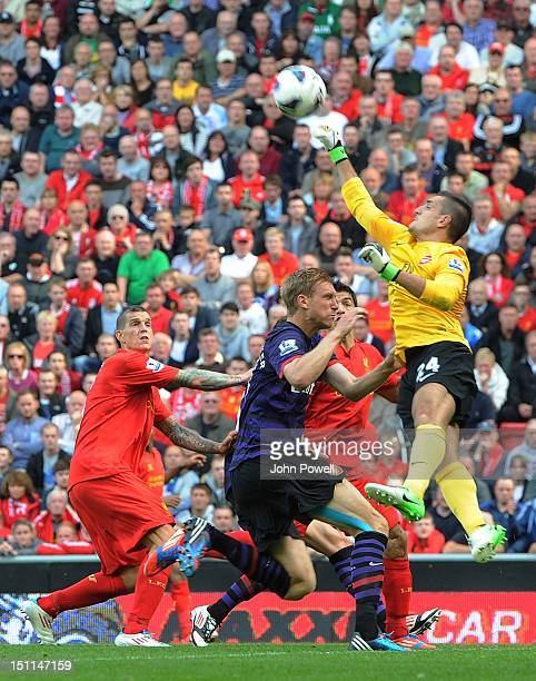 Vito Mannone of Arsenal punches the ball clear during the Barclays Premier League match between Liverpool and Arsenal at Anfield on September 2 2012...