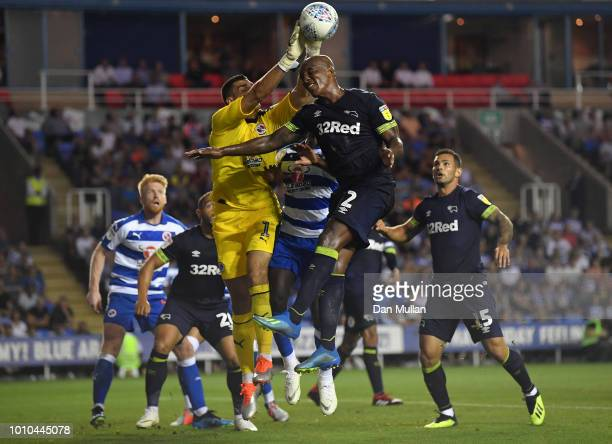 Vito Mannone of Reading clears the ball under pressure from Andre Wisdom of Derby County during the Sky Bet Championship match between Reading and...