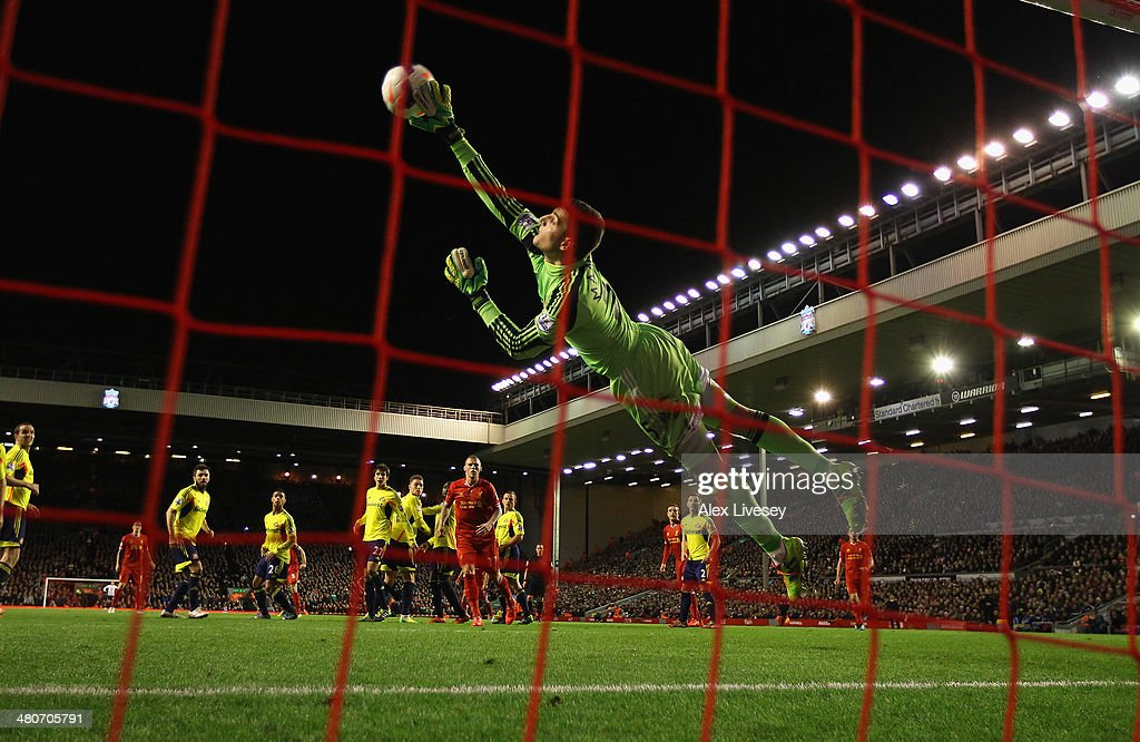 Vito Mannone of Sunderland is unable to stop Steven Gerrard of Liverpool scoring the first goal from a free-kick during the Barclays Premier League match between Liverpool and Sunderland at Anfield on March 26, 2014 in Liverpool, England.