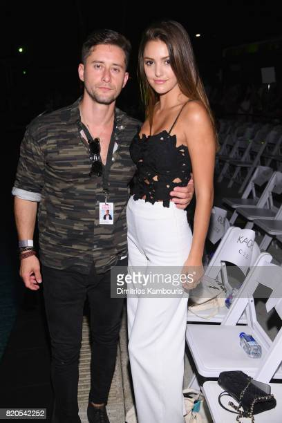 Vito Reznik and Jenna Crews attend the SWIMMIAMI KAOHS 2018 Collection fashion show at WET Deck at W South Beach on July 21 2017 in Miami Beach...