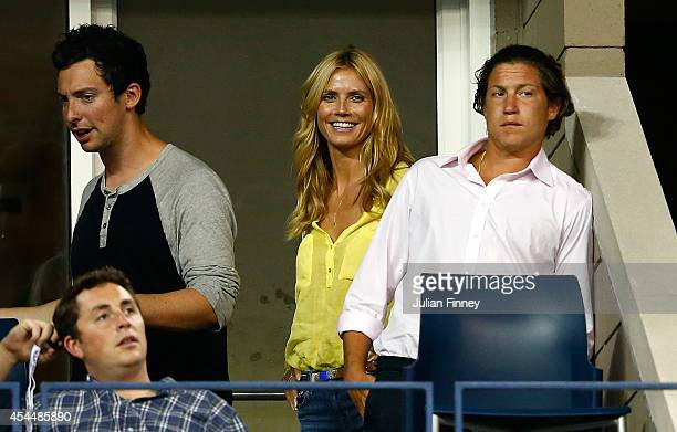 Vito Schnabel with Heidi Klum as Victoria Azarenka of Belarus plays Aleksandra Krunic of Serbia on Day Eight of the 2014 US Open at the USTA Billie...