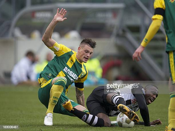 Vito Wormgoor of ADO Den Haag Geoffrey Castillion of Heracles Almelo during the Dutch Eredivisie match between ADO Den Haag and Heracles Almelo at...