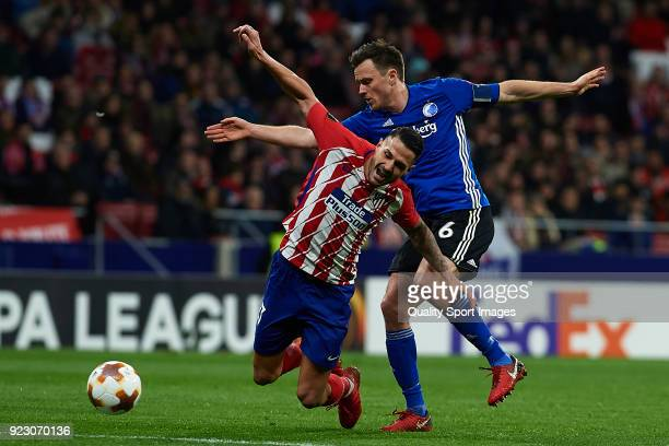 Vitolo Machin of Atletico Madrid and William Kvist of Copenhagen competes for the ball during UEFA Europa League Round of 32 match between Atletico...