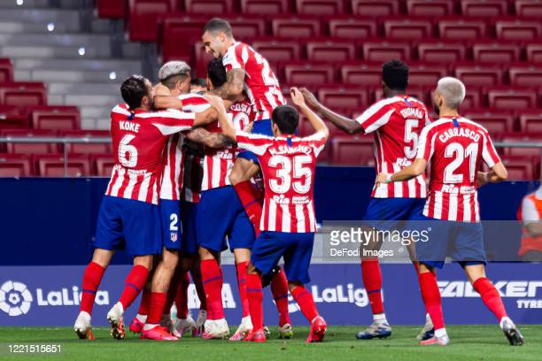 Vitolo of Atletico de Madrid celebrates after scoring his team's first goal with teammates during the Liga match between Club Atletico de Madrid and...