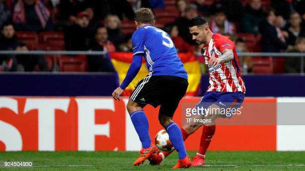 Vitolo of Atletico Madrid and Pierre Bengtsson of Copenhagen battle for the ball during the UEFA Europa League Round of 32 match between Atletico...