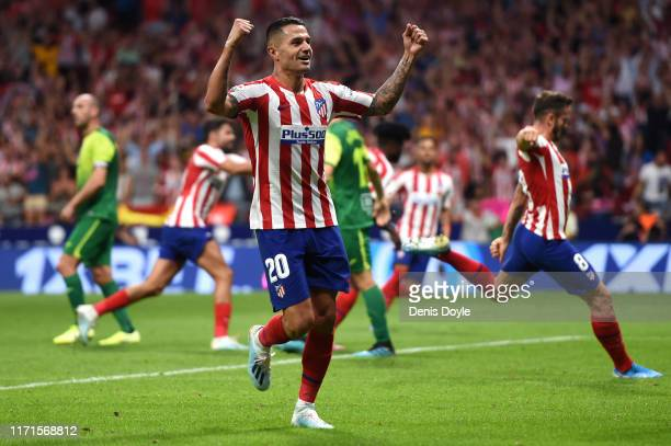Vitolo of Atletico Madrid celebrates his team's third goal scored by teammate Thomas Partey during the Liga match between Club Atletico de Madrid and...