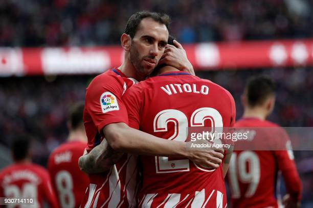 Vitolo of Atletico Madrid celebrates with his teammate Diego Godin after scoring a goal during the La Liga soccer match between Atletico Madrid and...