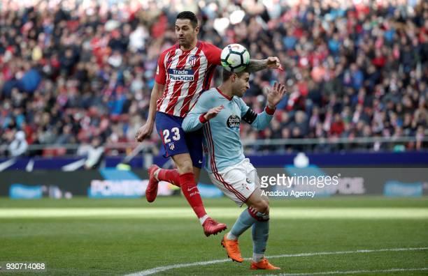 Vitolo of Atletico Madrid in action against Hugo Mallo of Celta Vigo during the La Liga soccer match between Atletico Madrid and Celta Vigo at Wanda...