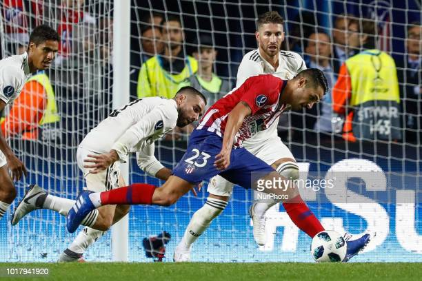Vitolo of Atletico Madrid in action against Raphael Varane Dani Carvajal and Sergio Ramos of Real Madrid during the UEFA Super Cup match between Real...