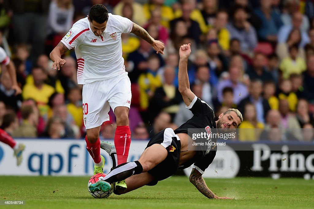 Vitolo of Sevilla battles with Valon Behrami of Watford during the pre season match beween Watford and Sevilla at Vicarage Road on July 31, 2015 in Watford, England.